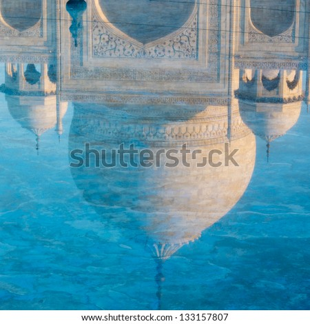 Reflection of the Taj Mahal dome in the water, Agra, India.