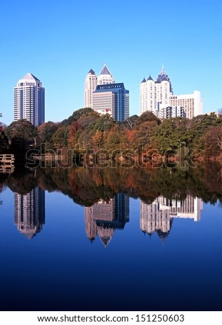 Reflections of skyscrapers in Piedmont Lake, Piedmont Park, Atlanta, Gerogia, USA.