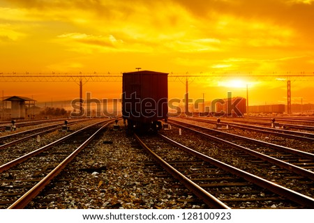 reight train passing by on sunset beam