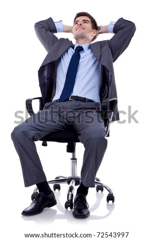 relaxed and dreaming business man sits on office chair over white background