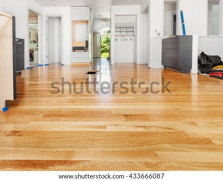 Remodeled kitchen has existing hardwood floor patched and refinished