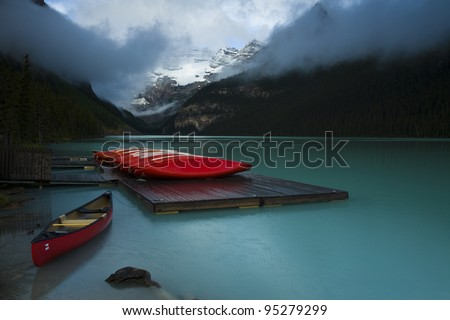 Rental boats on dock at the popular tourist site Lake Louise, Banff National Park (Alberta, Canada)