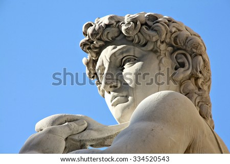 Replica of Michelangelo's David statue against blue sky, Florence, Italy