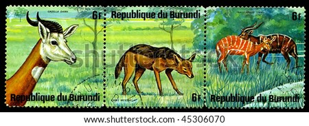 "REPUBLIC OF BURUNDI -  CIRCA 1976: a postage stamp shows image of the animals of savanna, ""gazella dama, canis mesomelas, tragelaphus specei"", circa 1976"