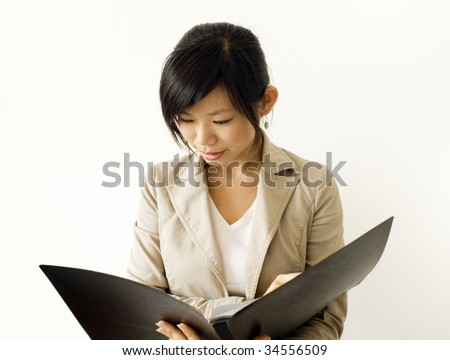 Research. Asian girl reading document. For education/business purpose.