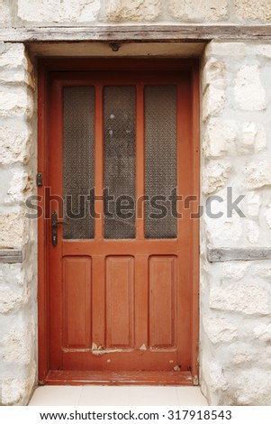 Residential house door. Vintage wooden door