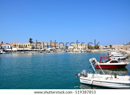 RETHYMNO, CRETE - SEPTEMBER 15, 2016 - View of fishing boats and waterfront restaurants in the inner harbour, Rethymno, Crete, Greece, Europe, September 15, 2016.