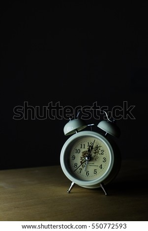 Retro alarm clock with low light and Old style filtered photo & Retro Alarm Clock Low Light Old Stock Photo 550772599 - Shutterstock azcodes.com