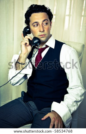 Retro - dressed up handsome man talking on the phone