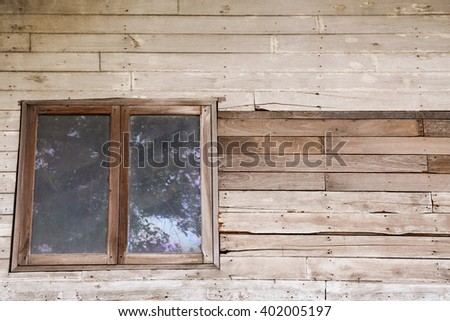 Retro image of a windows in vintage wall.