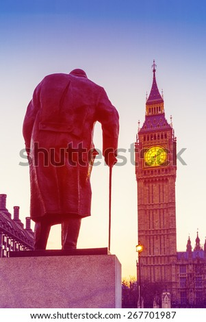 Retro Photo Effect - Statue of Sir Winston Churchill, looking towards Westminster Palace, Houses of Parliament, Elizabeth Tower, Big Ben, at Sunrise. London, England, UK.