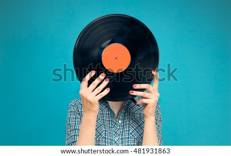 Retro picture of woman with vinyl record on blue background