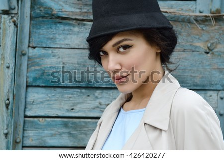 Retro portrait of a beautiful woman. Vintage style. Outdoor fashion photo. Female beauty.