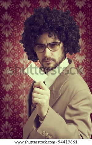 Retro portrait of a businessman with a business card