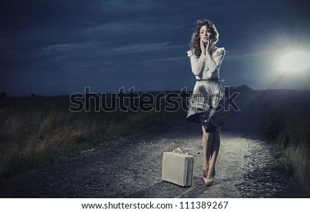 Retro woman with suitcase