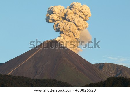 Reventador Volcano erupting at dawn, August 2016. The mountain is situated in a remote part of the Ecuadorian Amazon surrounded by rainforest.