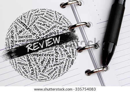 REVIEW word concept written on notebook