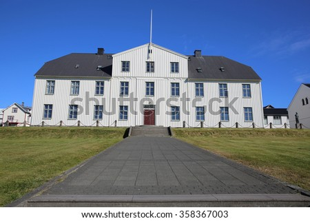 Reykjavik, Iceland - August 7, 2015: Reykjavik Junior College (Menntaskolinn), the oldest junior college in Iceland. A couple sunbathing on the meadow