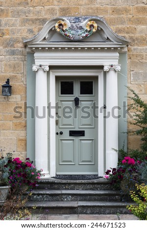 richly decorated wooden front door with pillars placed in a limestone facade & Richly Decorated Wooden Front Door Pillars Stock Photo 244671523 ... Pezcame.Com
