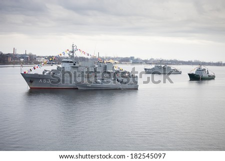 RIGA, LATVIA - NOVEMBER 18 2011:Latvian Naval Forces ships in river Daugava during parade of anniversary of establishment of the Republic of Latvia.