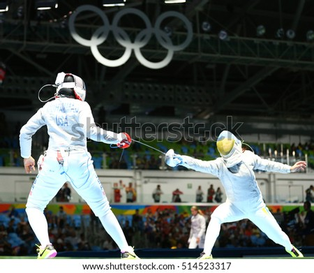 RIO DE JANEIRO, BRAZIL - AUGUST 8, 2016: Ibtihaj Muhammad of United States (L) and Olena Kravatska of Ukraine competes in the Women's individual sabre of the Rio 2016 Olympic Games at Carioca Arena 3