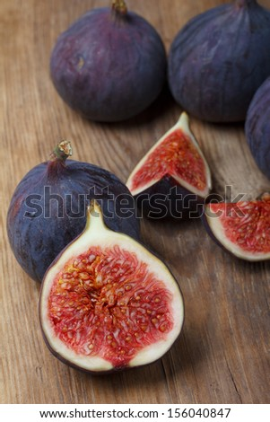 Ripe figs on wooden table still life