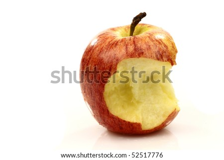 ripe fresh apple with a bite missing on a white background