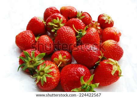 Ripe fresh strawberries on a white background.
