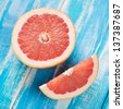 Ripe grapefruit on wooden boards, view from above, studio shot - stock photo