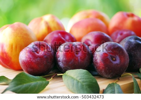 ripe plums and peaches