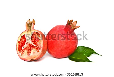 Ripe pomegranate and its section isolated on white background
