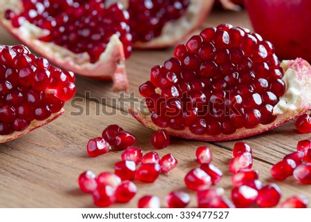 Ripe pomegranate on the wooden background . Close-up