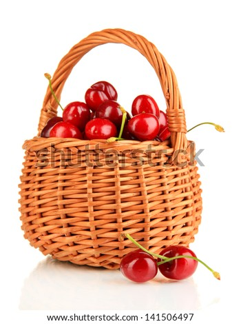 Ripe red cherry berries in basket isolated on white