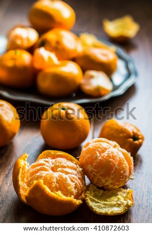 Ripe tangerine ruits on vintage plate on rustic kitchen
