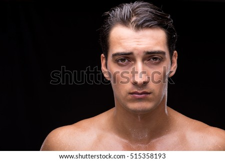Ripped muscular handsome man on black background