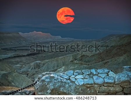 Rise of the super moon in desert of the Negev, Israel