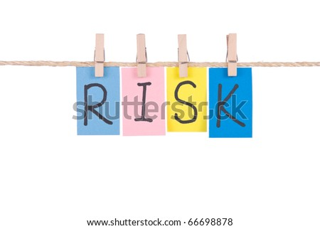Risk, Colorful words hang on rope by wooden peg