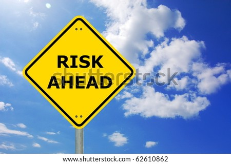 risk management concept with yellow road sign