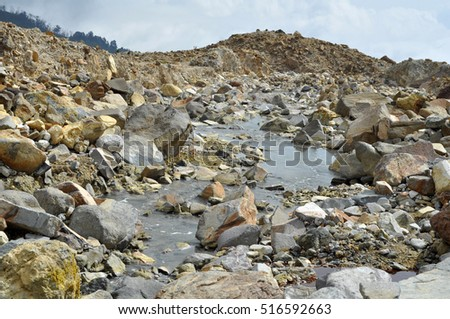 River and stone at sulfur quarry, Garut, Indonesia