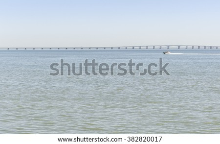 River and the sky with bridge and a speed boat - air everywhere