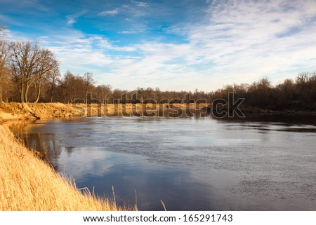 river in autumn on sky background