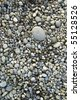 Riverbed pebbles viewed from above - stock photo