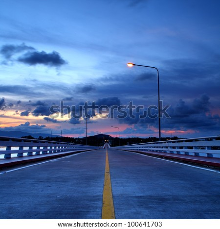 Road bridge on the sea at sunrise, Thailand