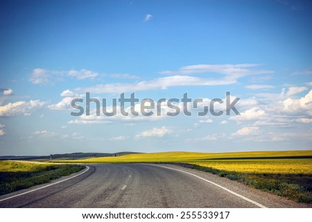 Road in the future, blue sky and clouds