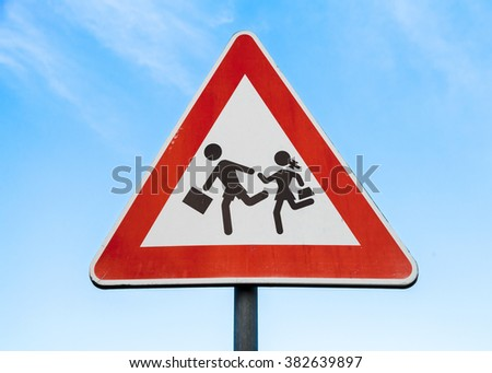 Road sign caution children over blue sky background