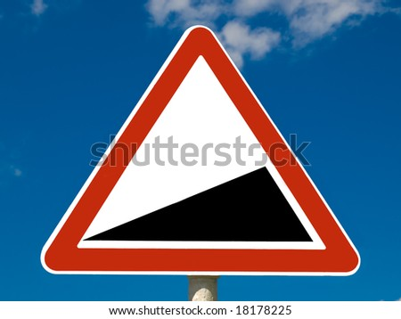 Road sign on sky background