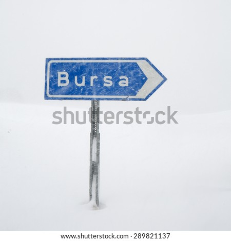 Road sign to Bursa under snow in Uludag, Turkey