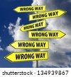 road sign yellow with words wrong way on blue sky background - stock photo