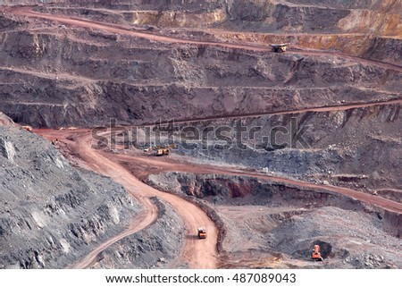 road with cars in the open pit