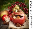 Roast apple with christmas decorations - stock photo